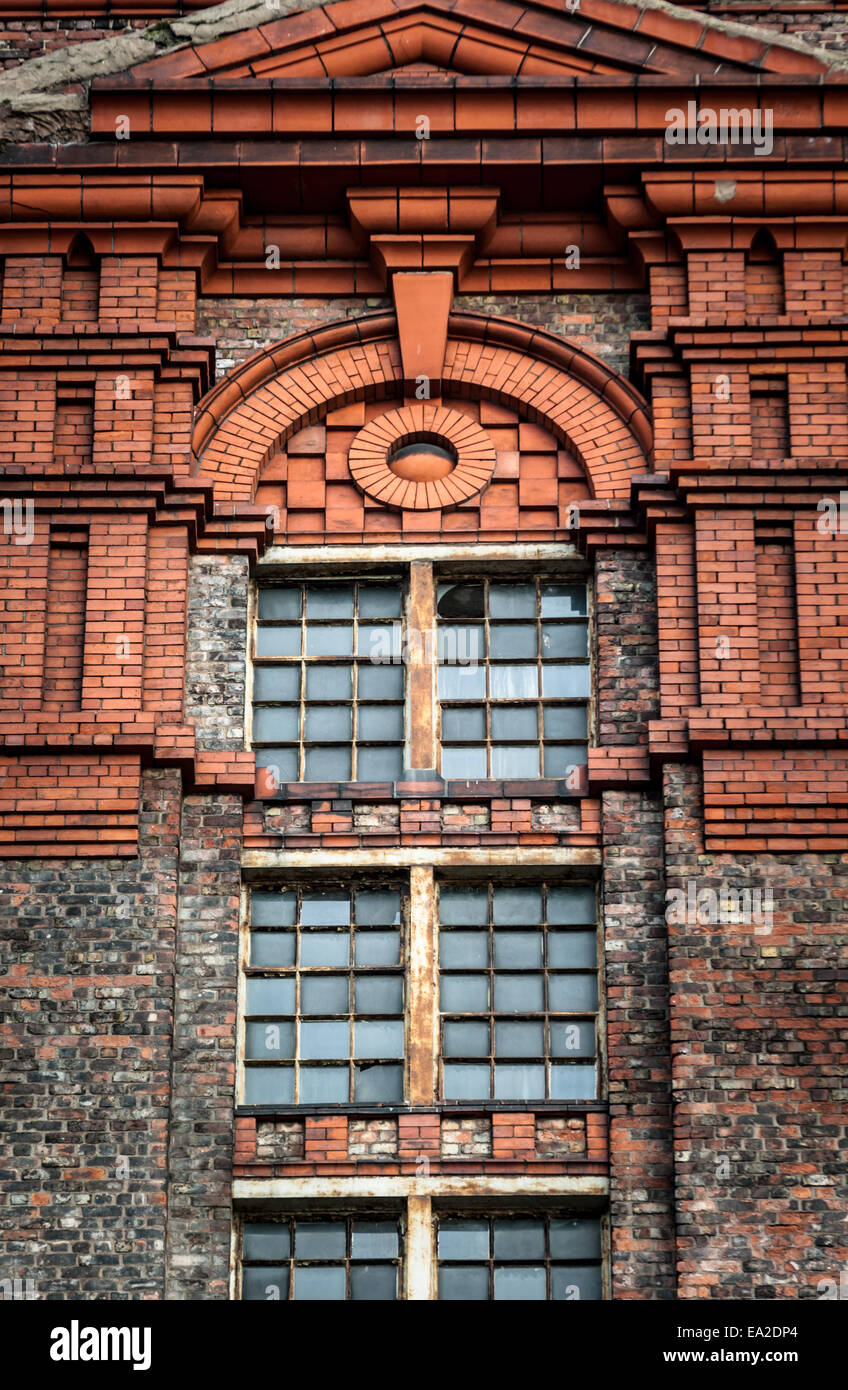 Detail around the window of a large brick built warehouse at the historic Stanley Dock Tobacco warehouse, Liverpool. Stock Photo