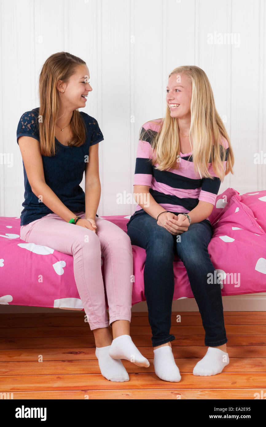 Teens on bed