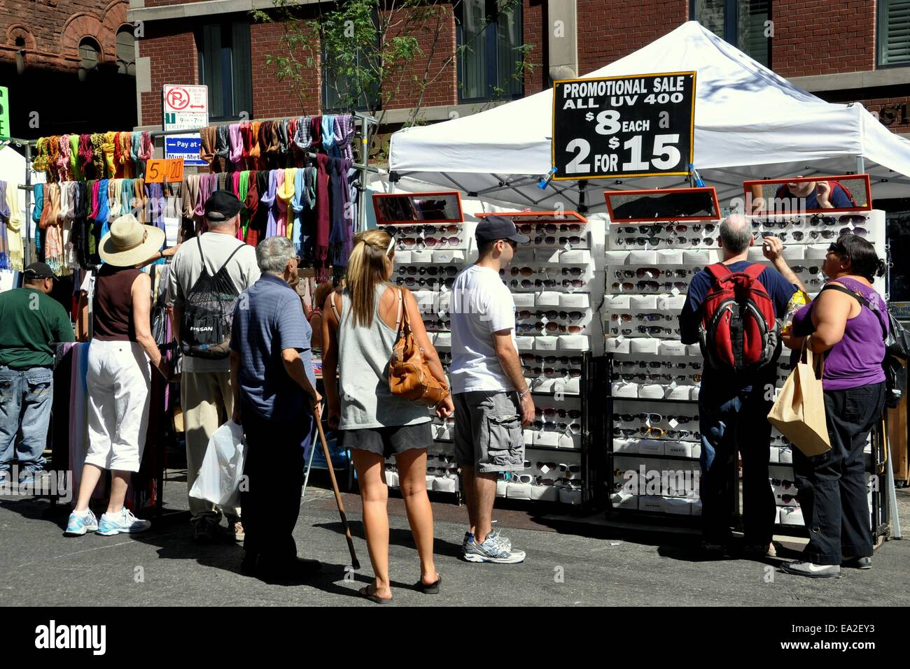 NYC: People shopping for pashmina scarves and UV 400 sun