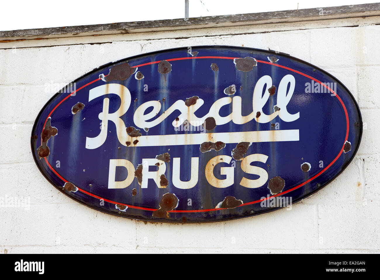 old metal rusting rexall drugs store sign Saskatchewan Canada - Stock Image