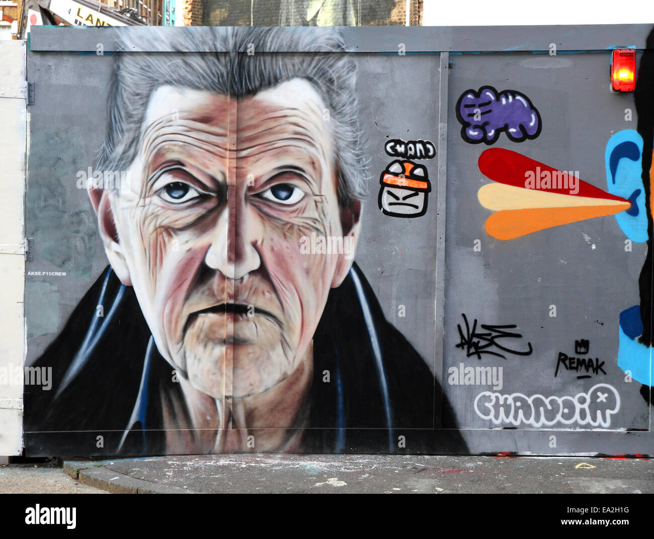 7 feet high portrait of a mans face on street hoarding in East London, England - Stock Image