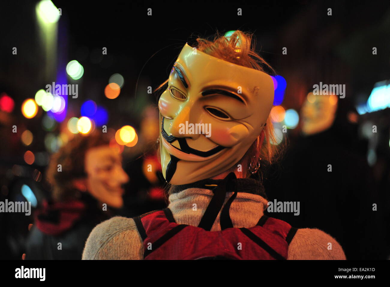 London, Ontario, Canada. 5th November, 2014.  Protesters aligned with the Anonymous movement march through London - Stock Image