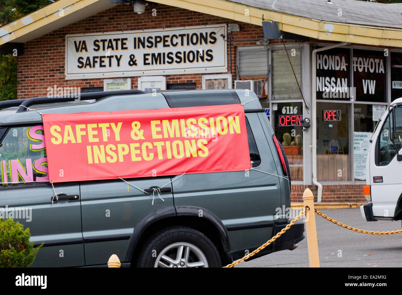 Virginia state safety and emission inspections banner at service station - Virginia USA - Stock Image
