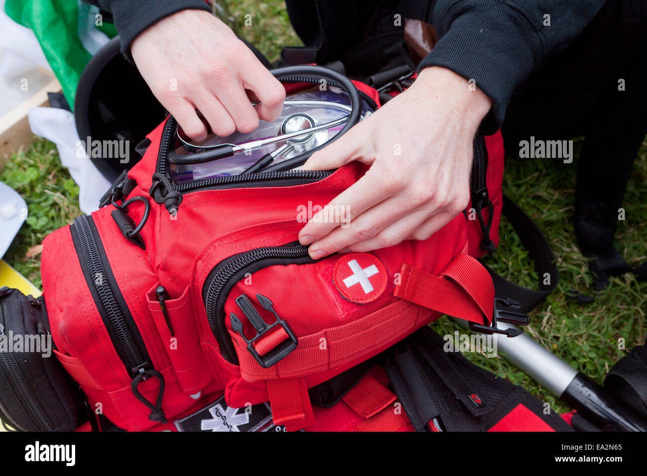 EMT personnel preparing first aid kit - USA - Stock Image