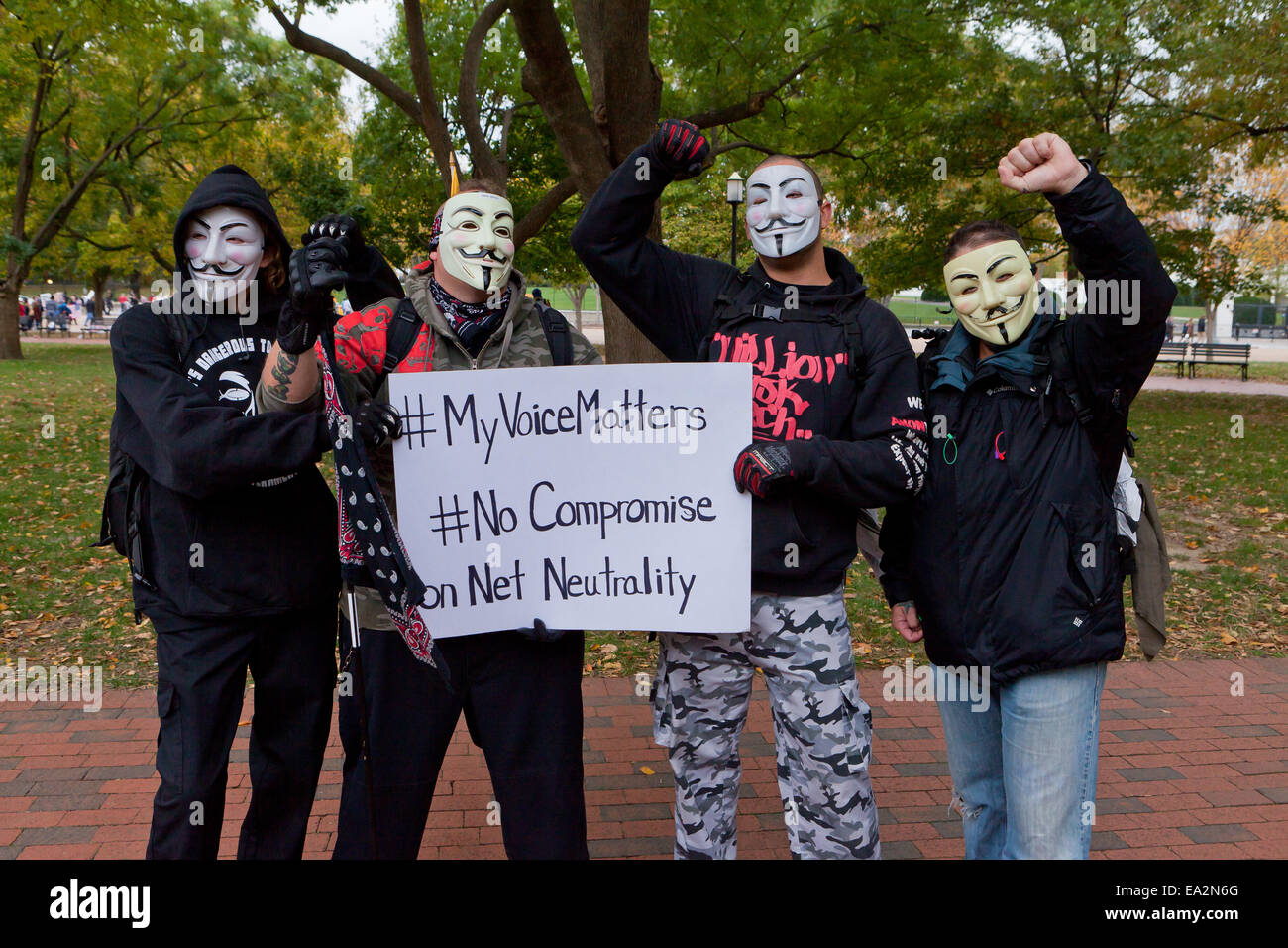 Anonymous members holding pro-net neutrality message  - USA - Stock Image