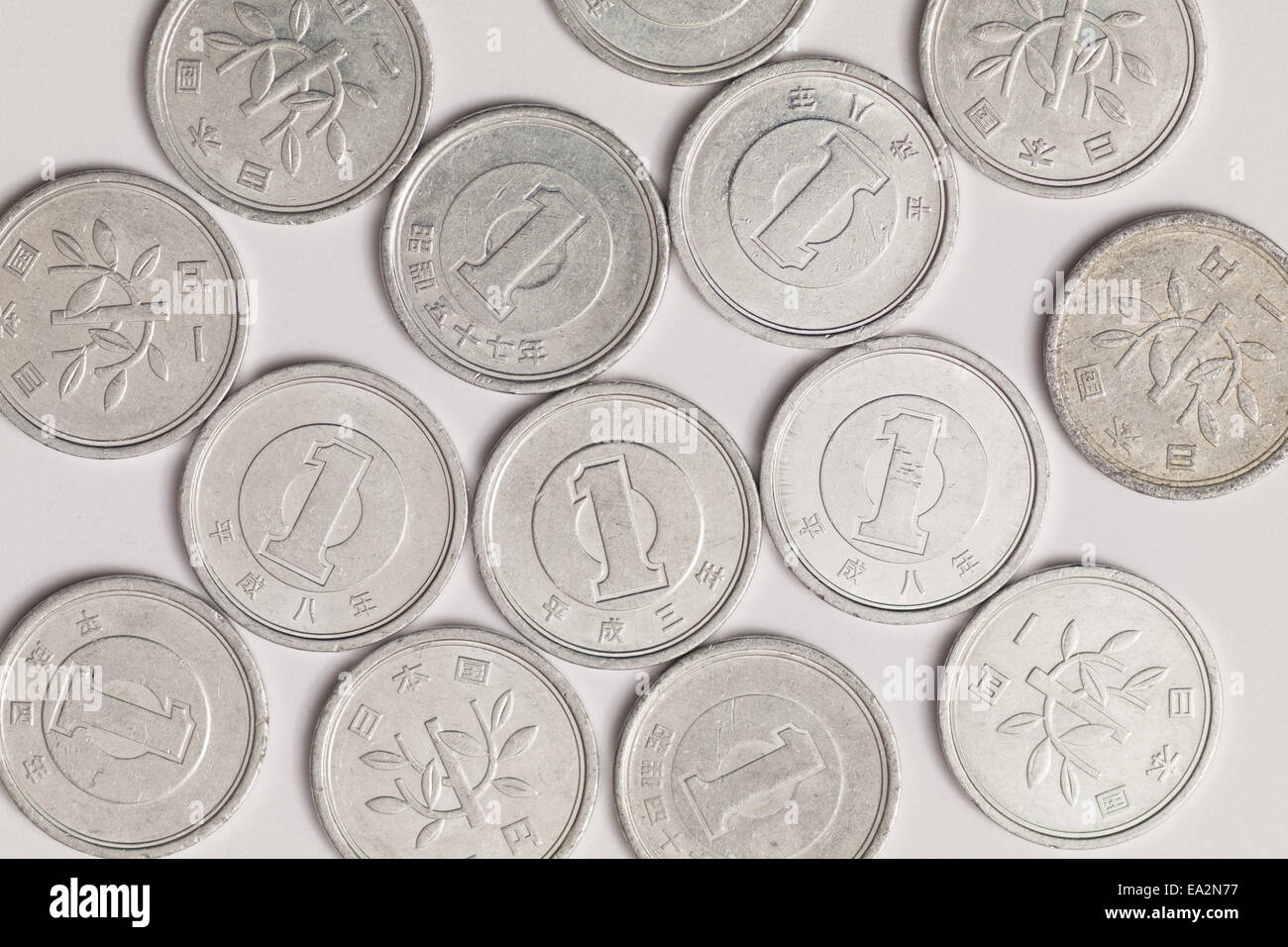 A close-up of Japanese one yen coins (1 yen coins), the smallest denomination of Japanese yen currency. - Stock Image