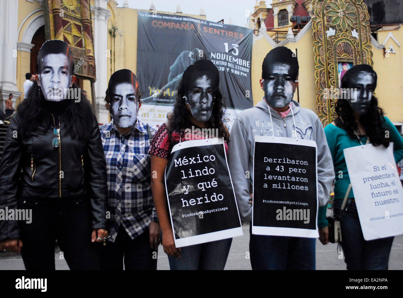 Iguala, Guerrero, Mexico. 5th November, 2014. Some wore masks with the faces of missing normalistas, others brought Stock Photo