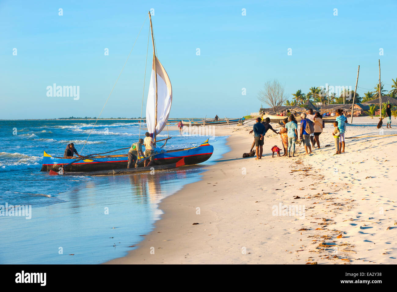 Malagasy fishermen coming back from a fishing trip, Morondava, Toliara province, Madagascar, Africa - Stock Image