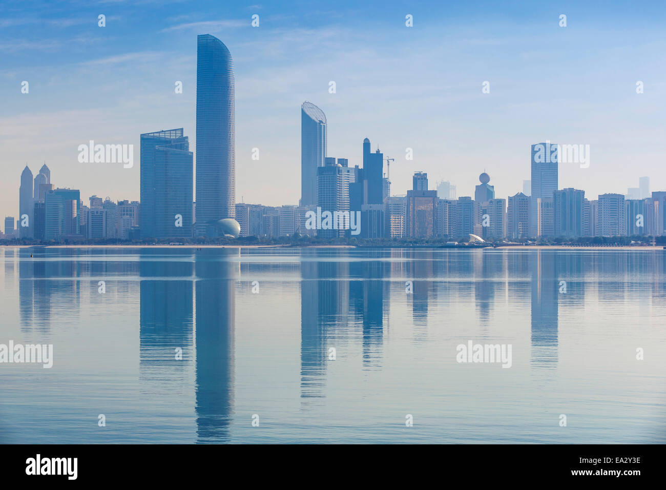 View of City skyline reflecting in Persian Gulf, Abu Dhabi, United Arab Emirates, Middle East - Stock Image