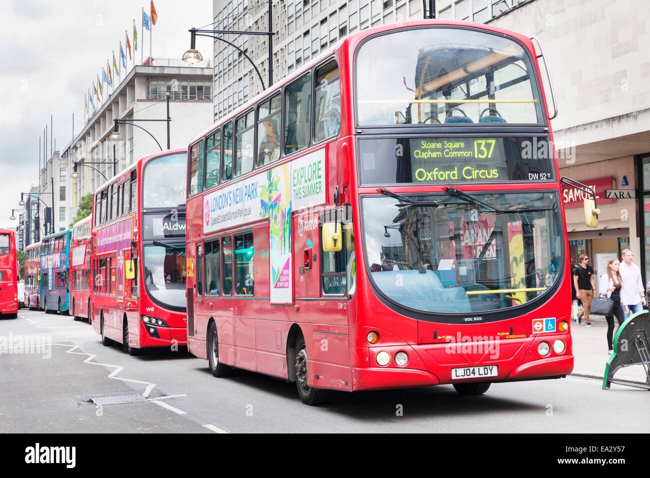 Red double decker bus on Oxford Street, London, England, United Kingdom, Europe - Stock Image