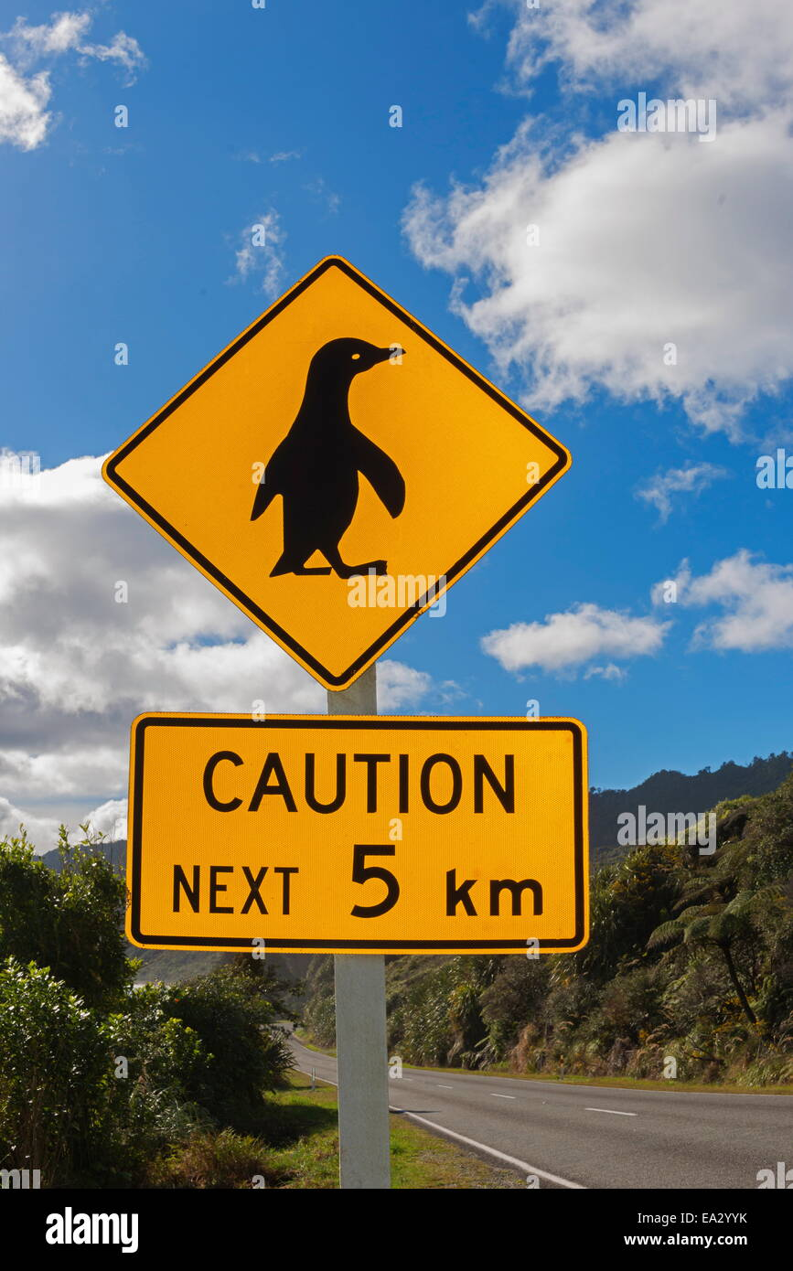 Penguin crossing sign, West Coast, South Island, New Zealand, Pacific - Stock Image