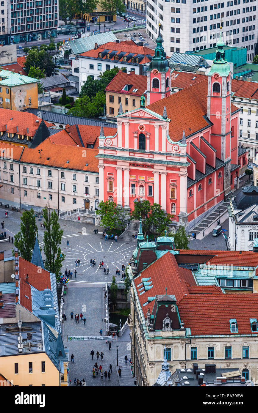 Franciscan Church of the Annunciation, across the Triple Bridge in Preseren Square, seen from Ljubljana Castle, - Stock Image