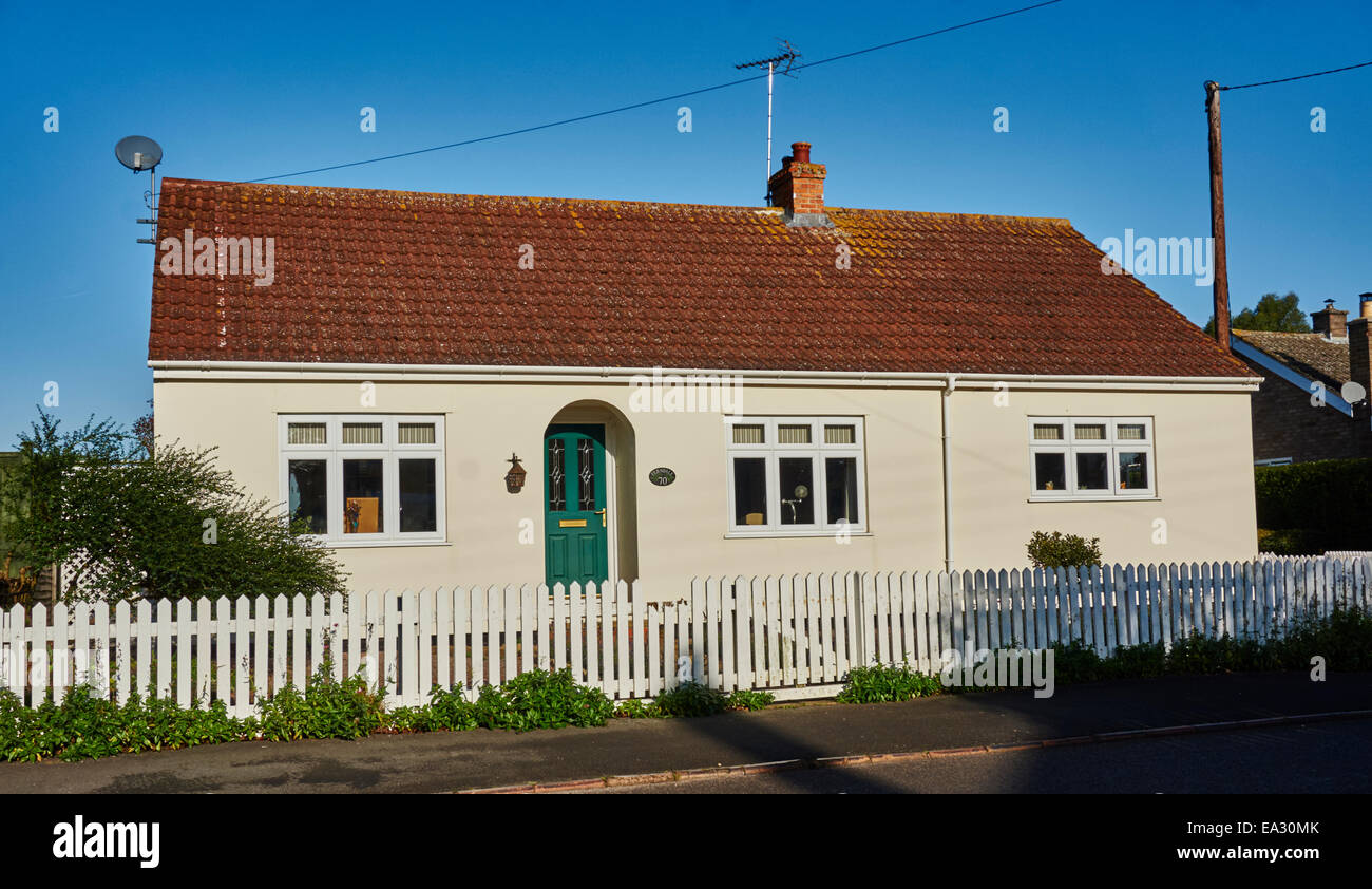 Rendered bungalow facing the sun against a clear, blue sky in Langtoft village, Lincolnshire, near Peterborough, - Stock Image