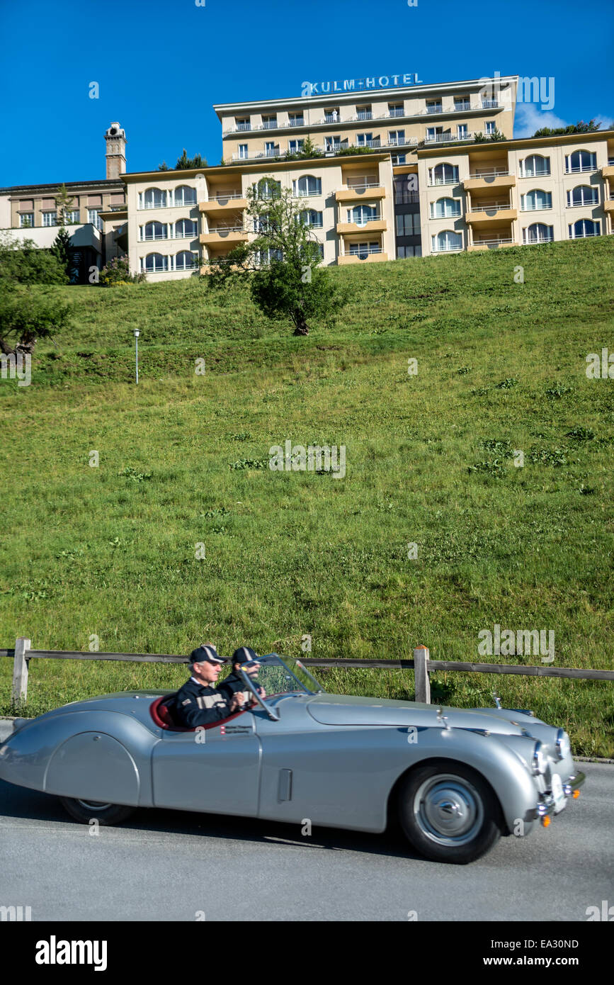 Jaguar vintage car in front of the Kulm Hotel during annual the British Classic Car Meeting 2014, St.Moritz, Switzerland. - Stock Image