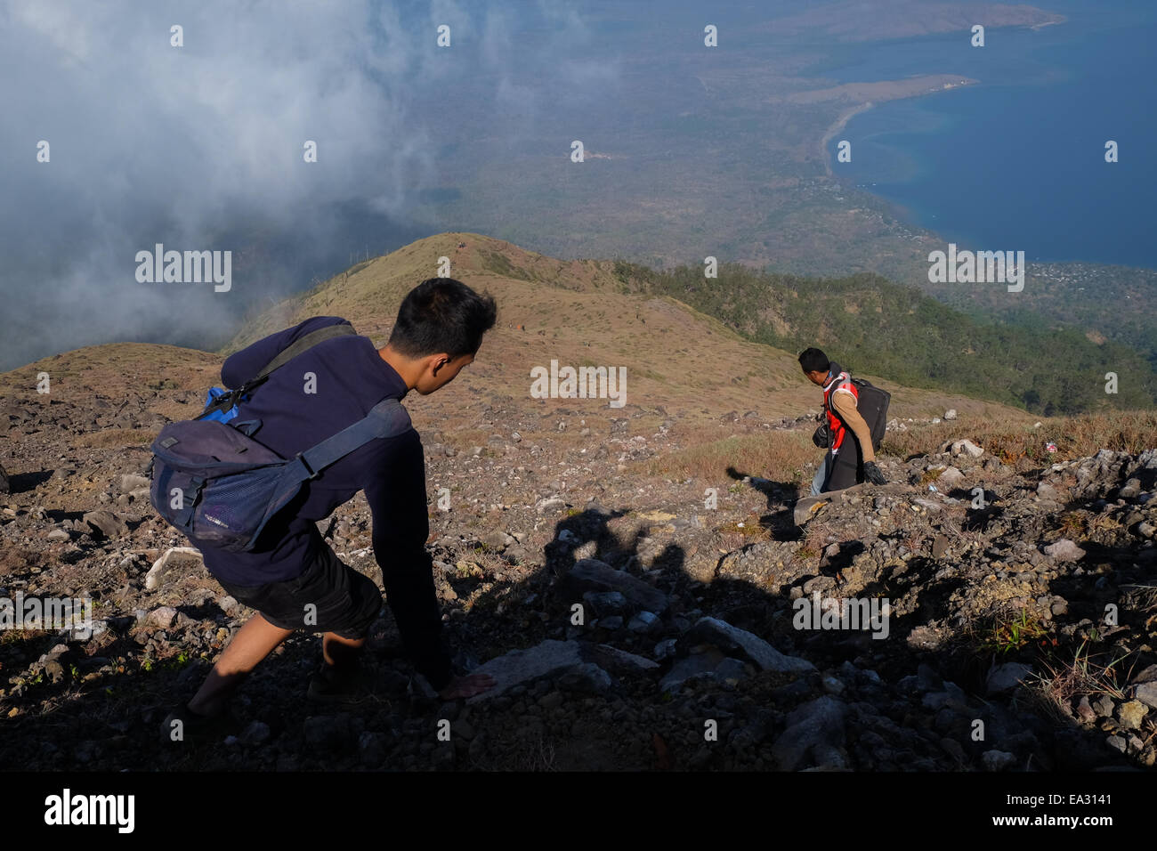 Mountaineering activity atop Ile (Mount Lewotolok), Lembata Island, East Nusa Tenggara, Indonesia. - Stock Image