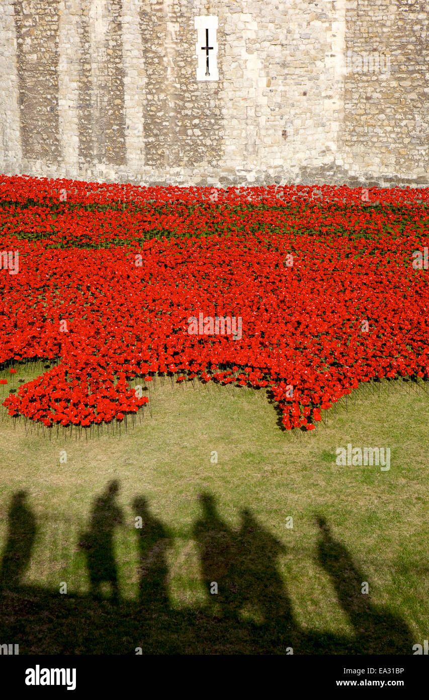 Shadows of people viewing Blood Swept Lands and Seas of Red installation at The Tower of London, London, England, - Stock Image