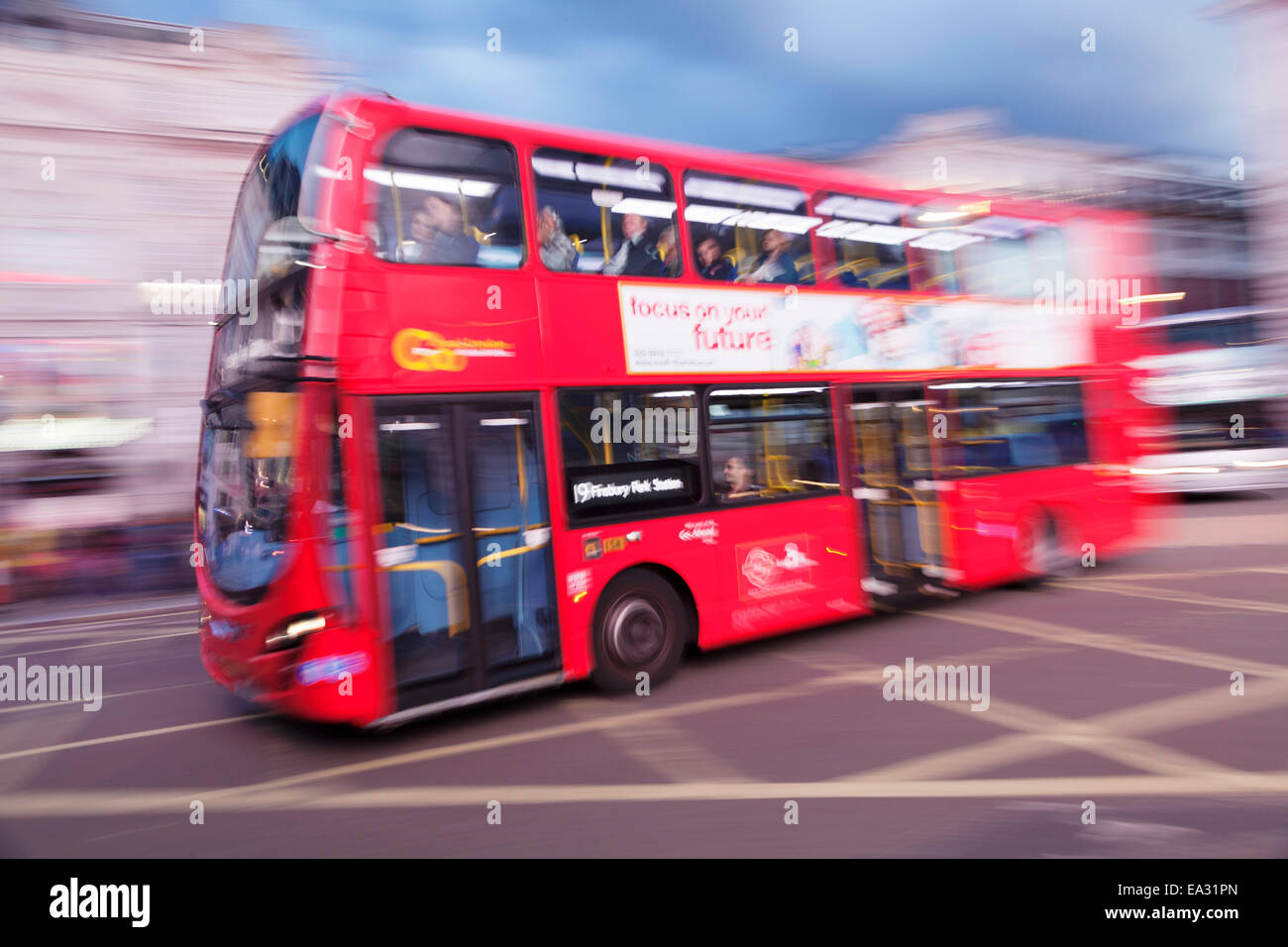 Motion blurred red double decker bus, Piccadilly Circus, London, England, United Kingdom, Europe - Stock Image