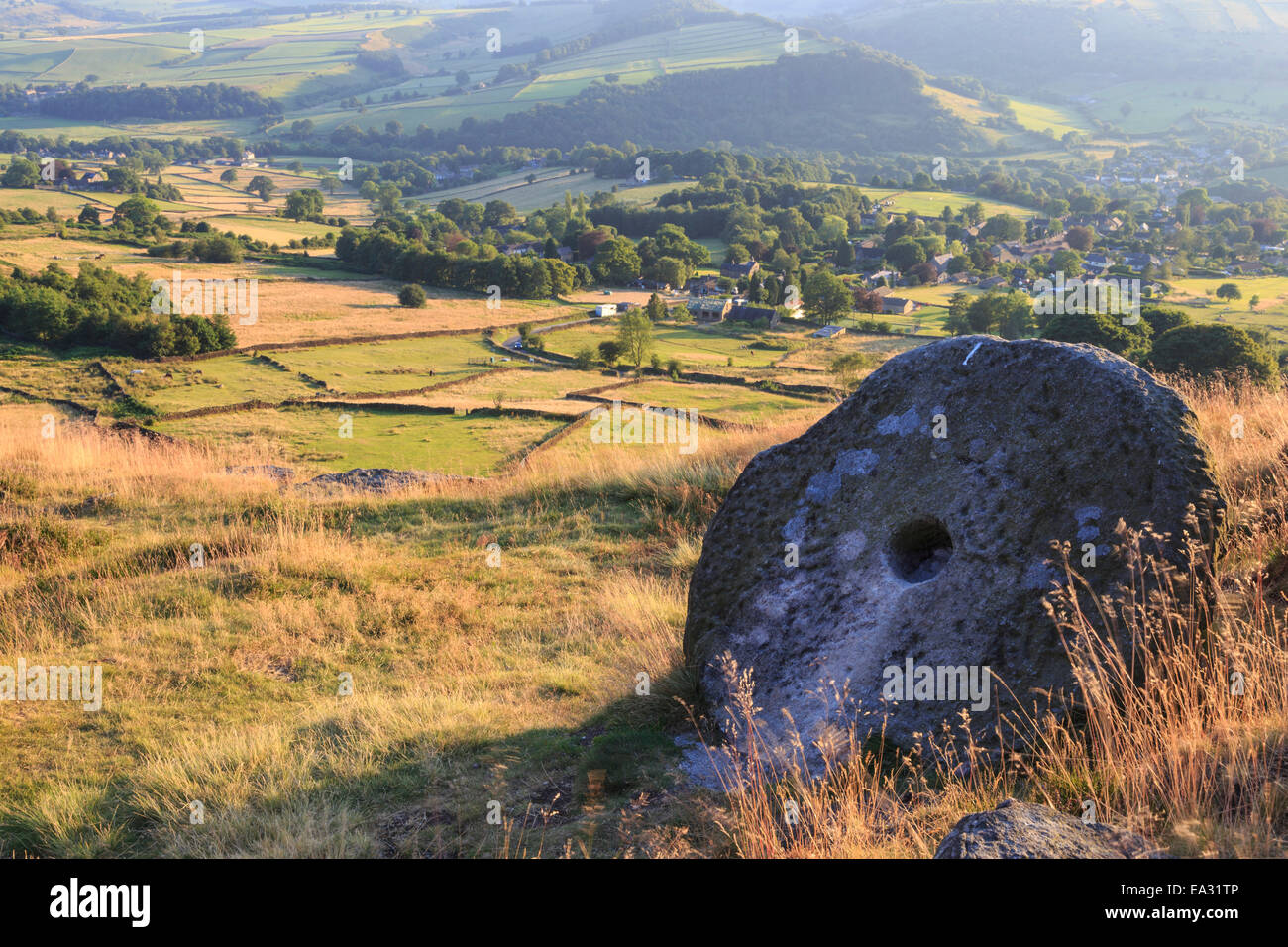 Millstone and golden fields above Curbar in summer, Curbar Edge, Peak District National Park, Derbyshire, England, - Stock Image