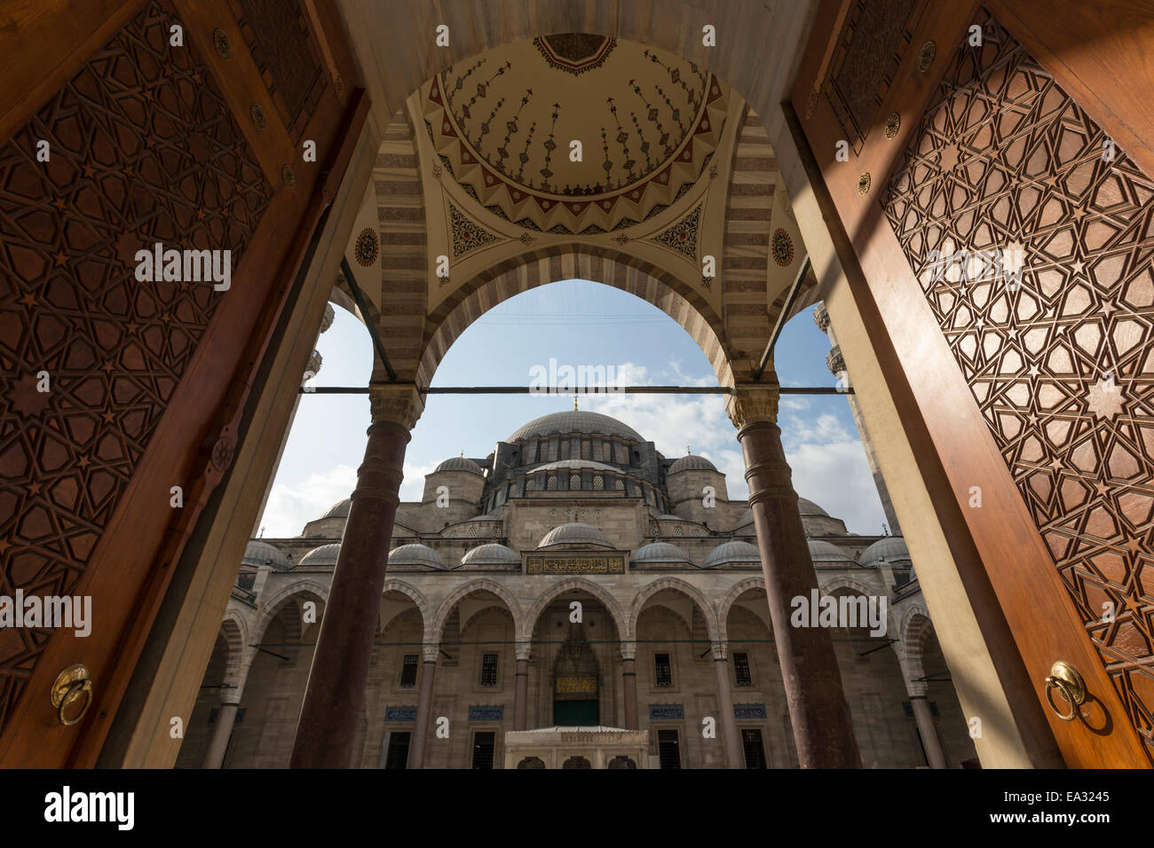 Ornate wooden doors, Courtyard entrance, early morning, Suleymaniye Mosque, Bazaar District, Istanbul, Turkey, Europe Stock Photo