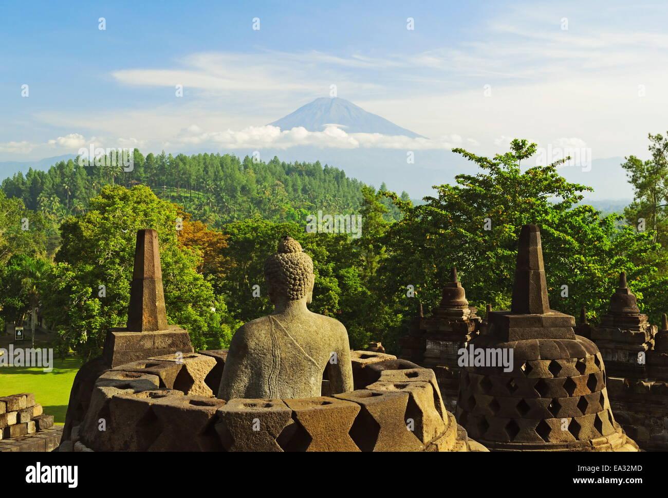 Borobodur, UNESCO World Heritage Site, with Mount Merapi in the distance, Kedu Plain, Java, Indonesia, Southeast - Stock Image