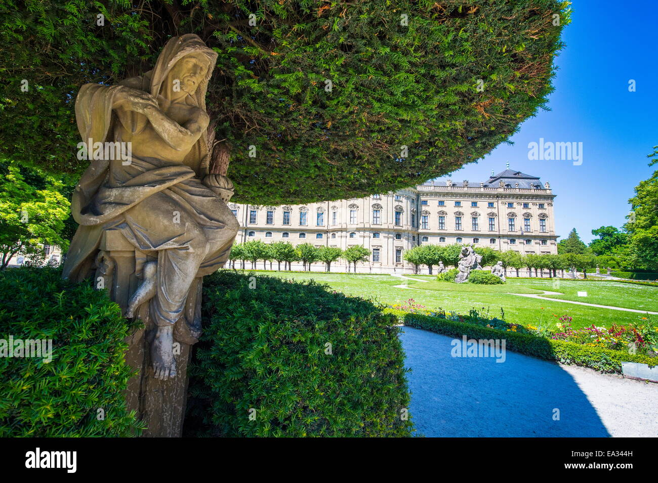 Statue under a tree in the Baroque gardens in the Wurzburg Residence, UNESCO Site, Wurzburg, Franconia, Bavaria, - Stock Image