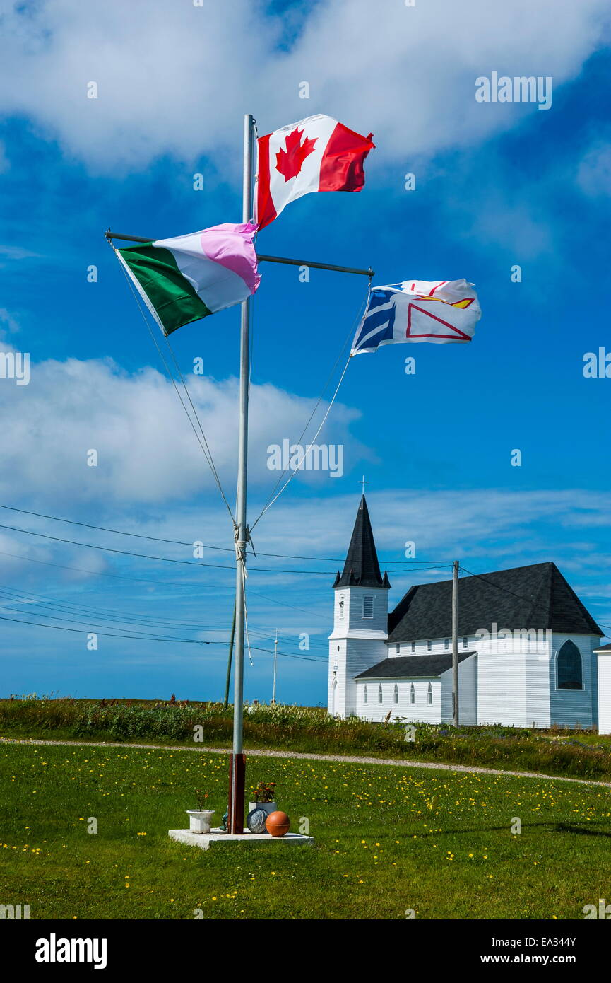 Flag pole in front of a church in Flower Cove, Newfoundland, Canada, North America - Stock Image