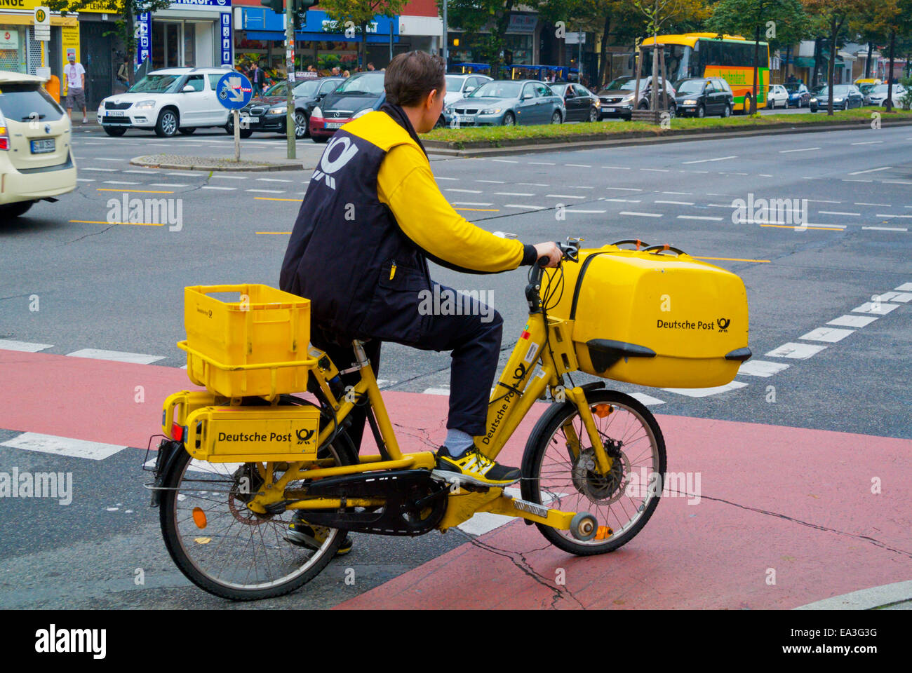 Deutsche Post, German postal company, postman on bike, Kreuzberg, west Berlin, Germany - Stock Image