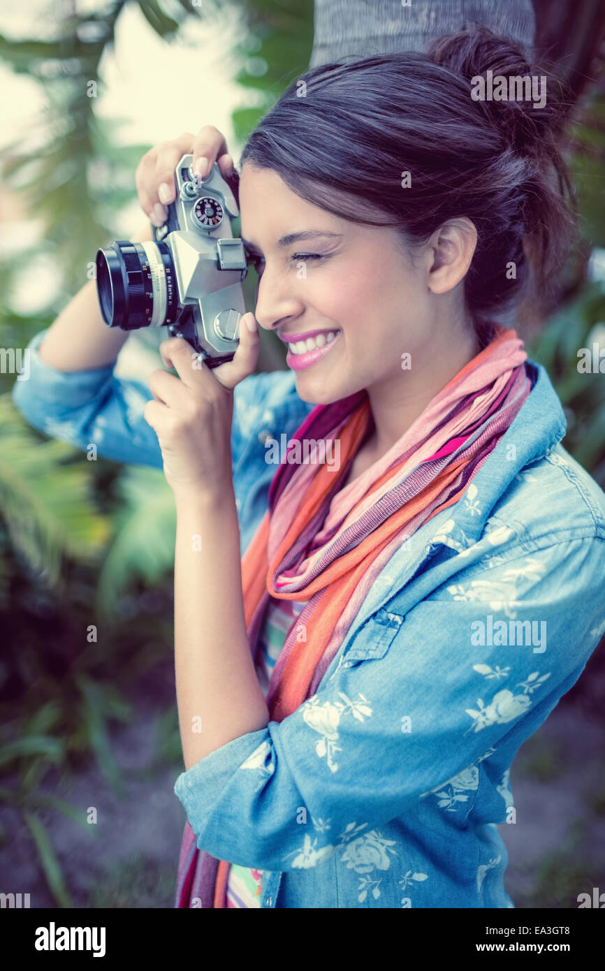 Cheerful brunette taking a photo outside Stock Photo
