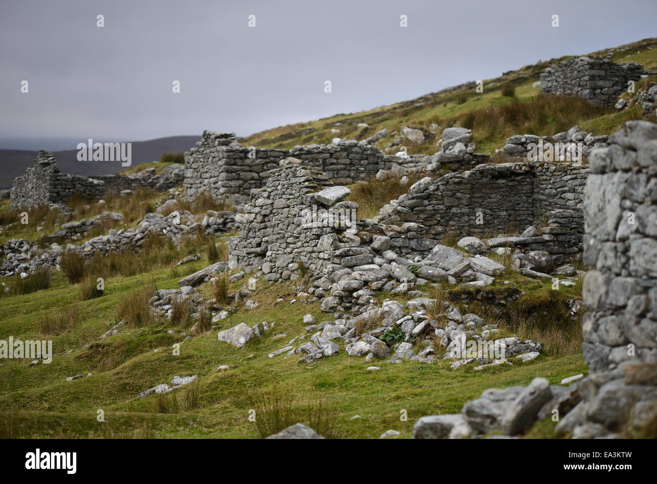 Deserted Village, Slievemore mountain, Co Mayo, Achill Island. Ireland, Village of approx 80 houses. Landscape - Stock Image