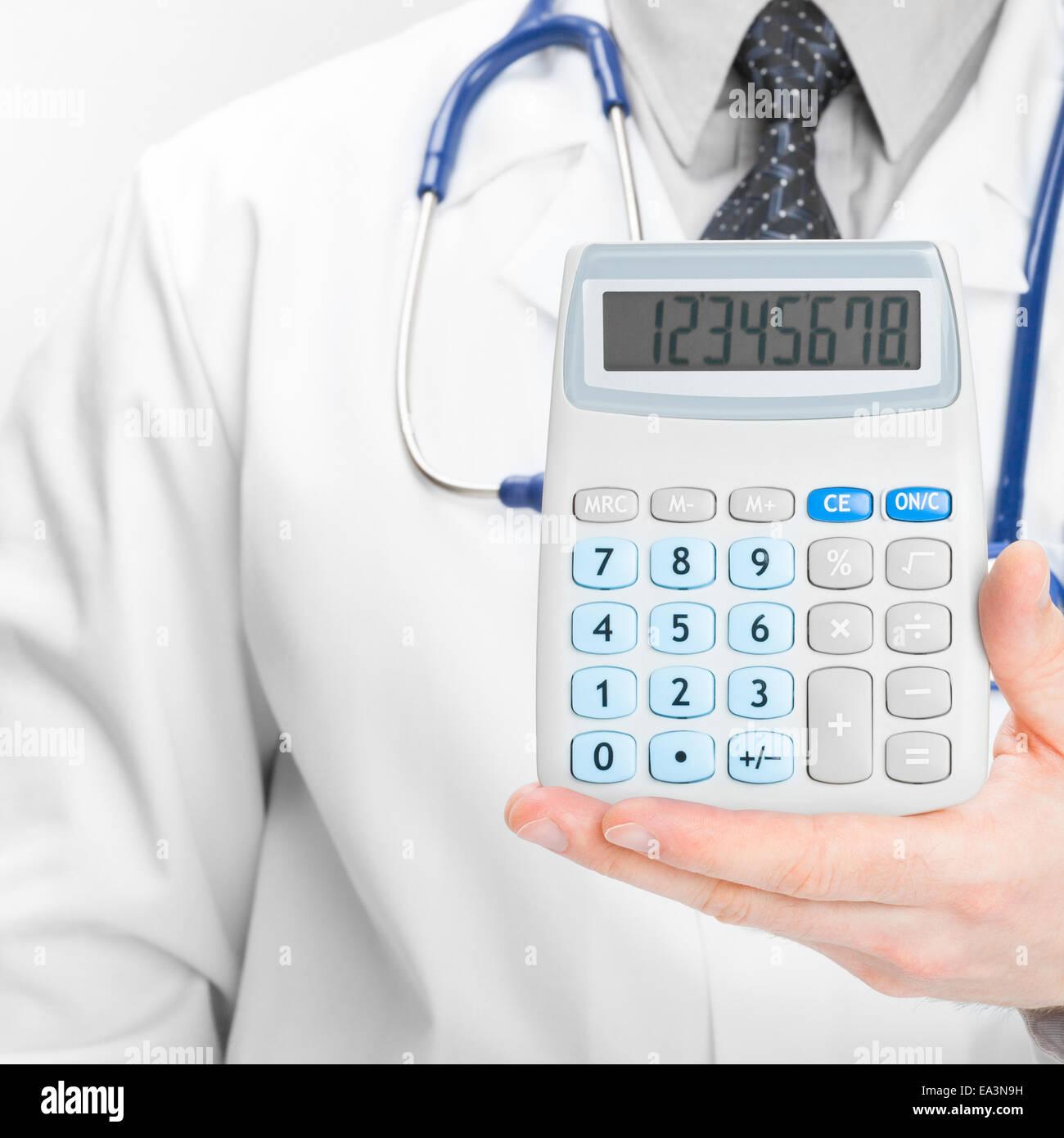 Doctor holdling calculator - heath care concept Stock Photo
