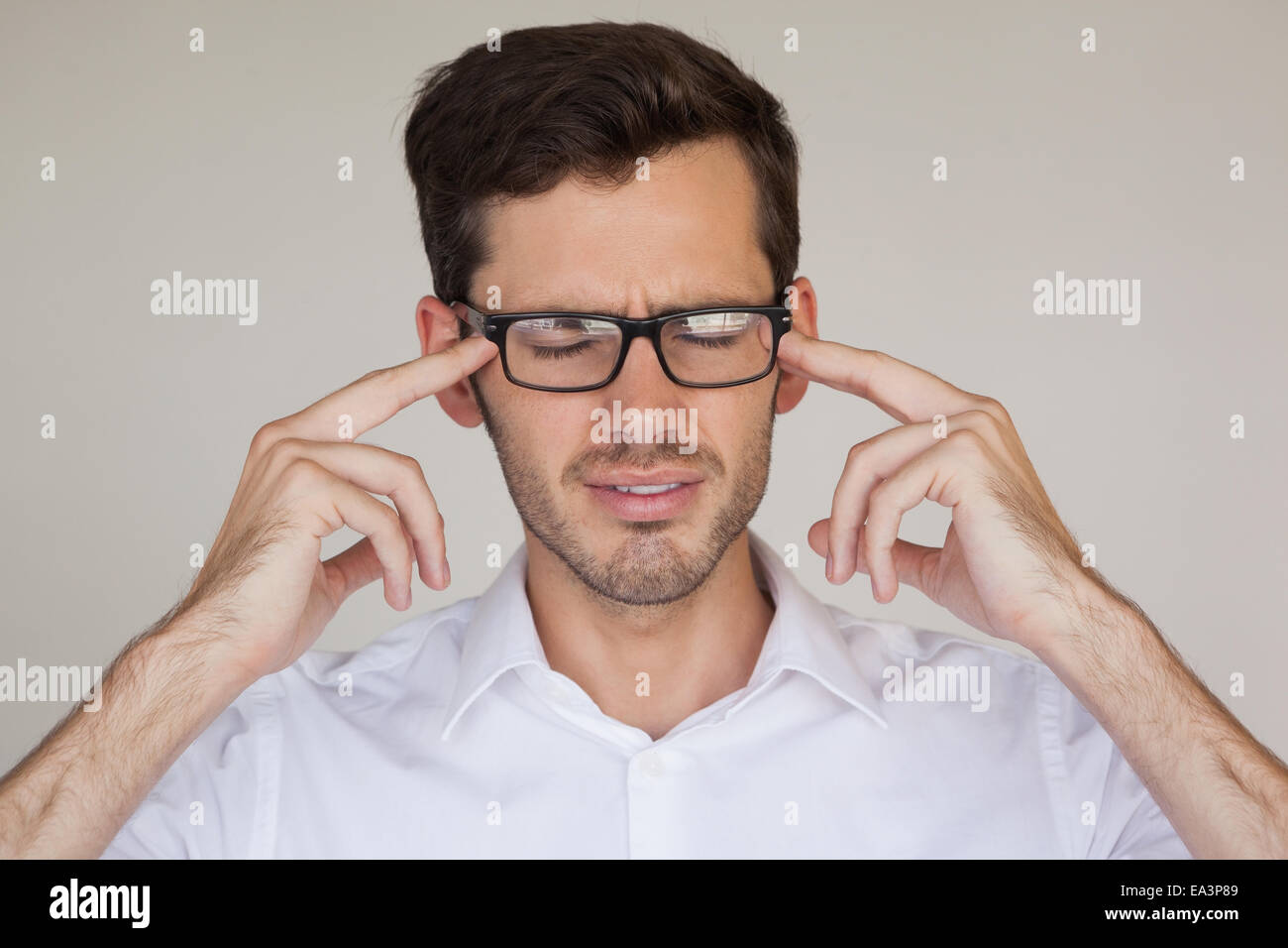 Casual businessman getting a headache - Stock Image