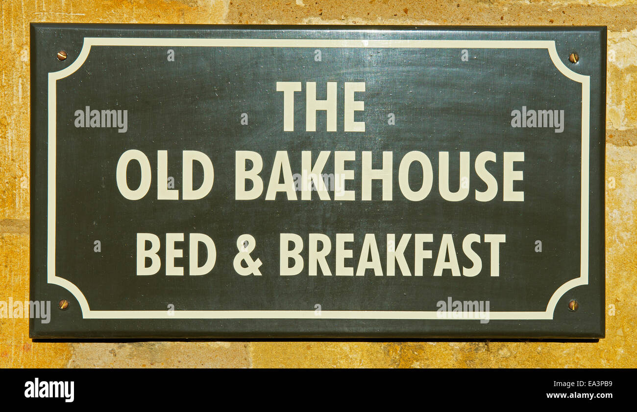 Sign on house - The Old Bakehouse Bed & Breakfast - in Chipping Campden, Cotswolds, Gloucestershire, England - Stock Image