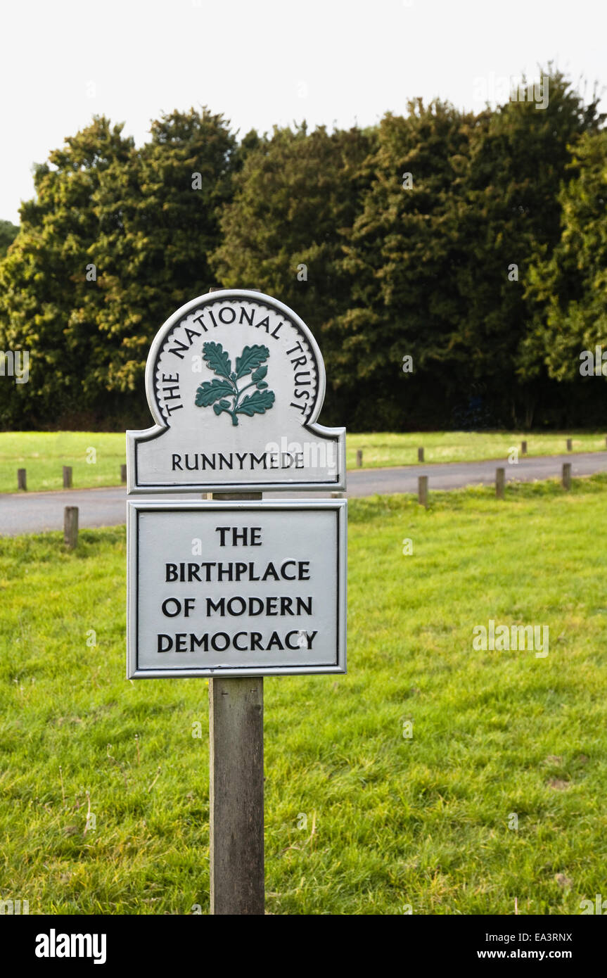 National Trust sign at Runnymede meadows which commemorates The Birthplace of Modern Democracy. UK. - Stock Image