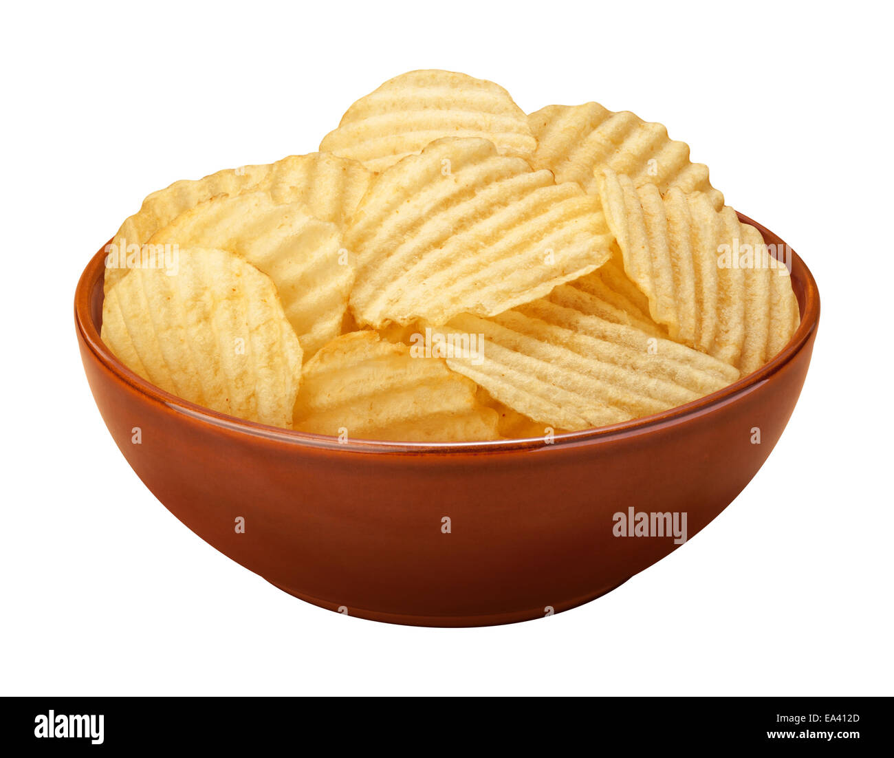 Wavy potato chips with ridges, sometimes called ruffles, in a brown ceramic bowl isolated on a white background. - Stock Image