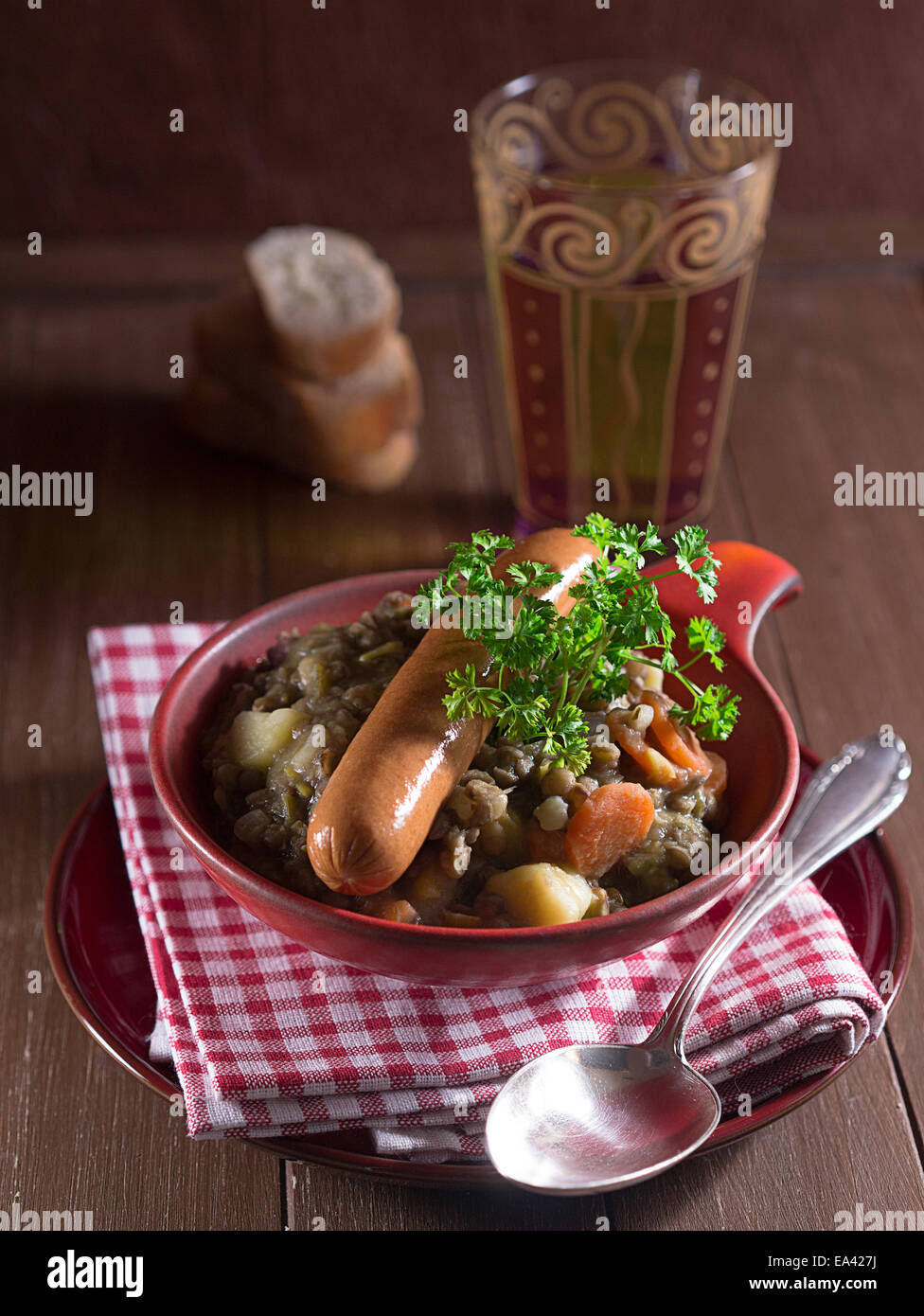 Lentil soup with sausages in a bowl Stock Photo
