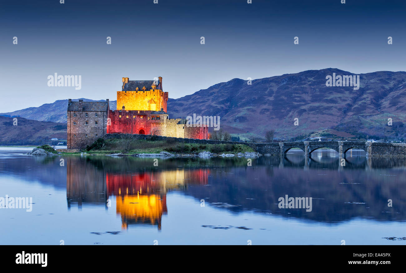 EILEAN DONAN CASTLE WITH EVENING LIGHTING FOR ARMISTICE DAY NOVEMBER 11 2014 - Stock Image