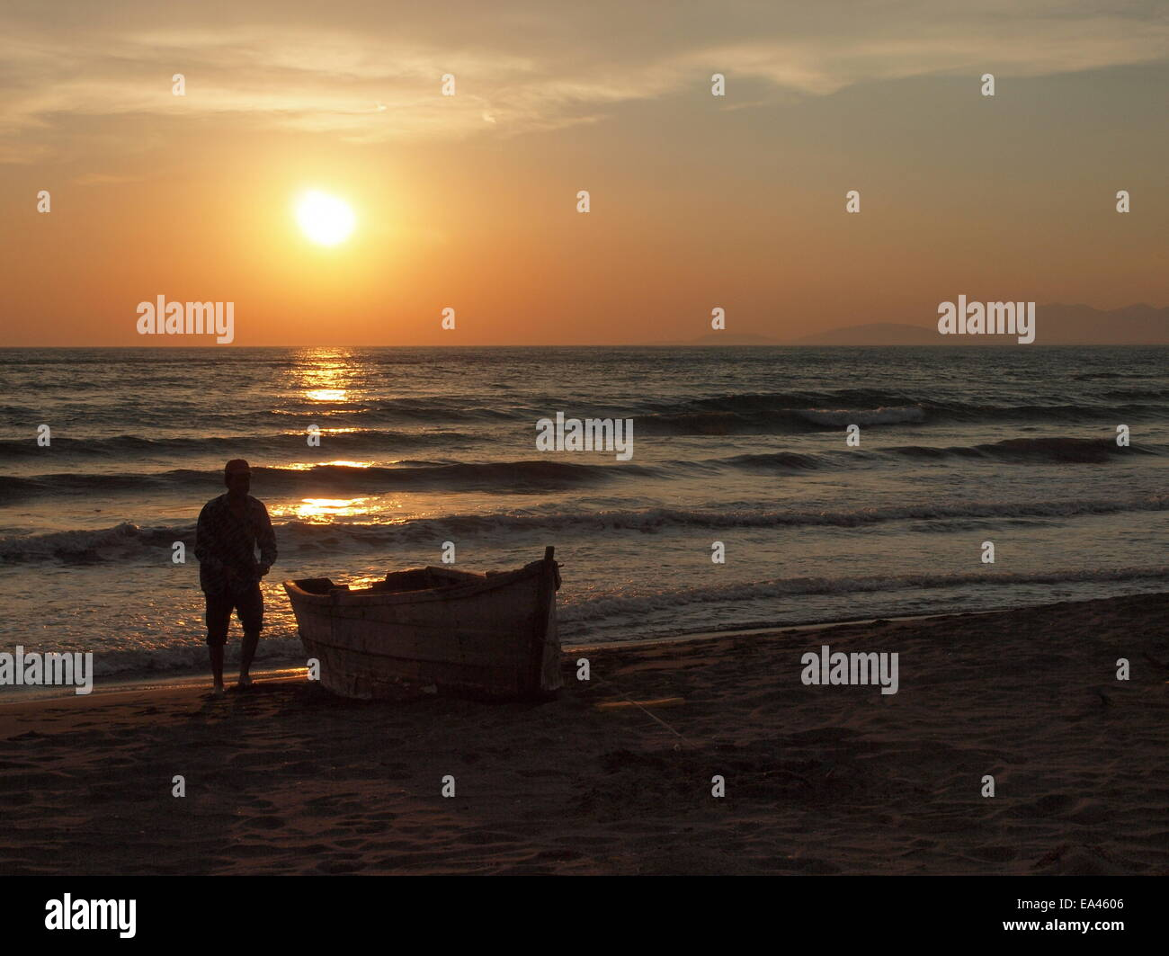 Fisherman in Albania at sunset - Stock Image