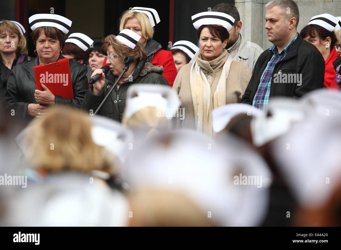 Gdansk, Poland. 6th November, 2014. Nurses and midwives protest  in front of the Pomeranian Marshal Office in Gdansk. - Stock Image