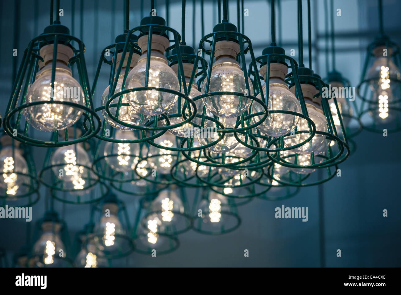 Abstract interior fragment. Stylized vintage illumination with modern LED lamps in metal lampshades - Stock Image