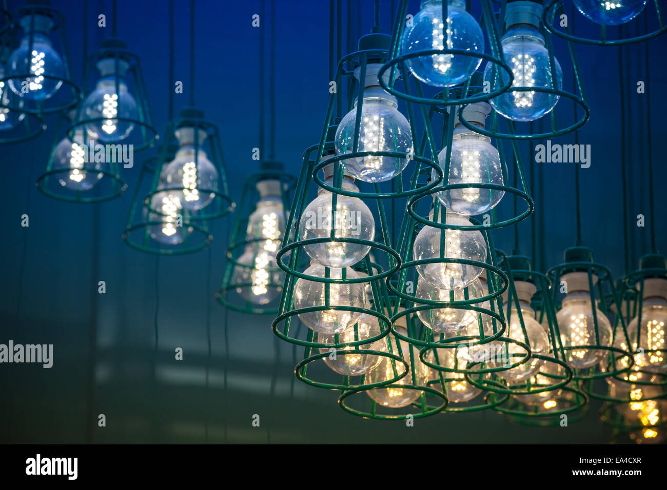 Abstract interior fragment. Stylized vintage colorful illumination with modern LED lamps in metal lampshades - Stock Image
