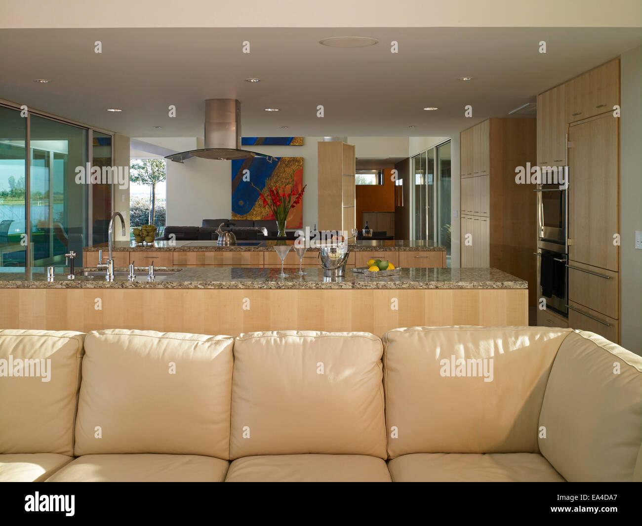 https://c8.alamy.com/comp/EA4DA7/open-plan-kitchen-and-living-room-of-border-house-arvin-california-EA4DA7.jpg
