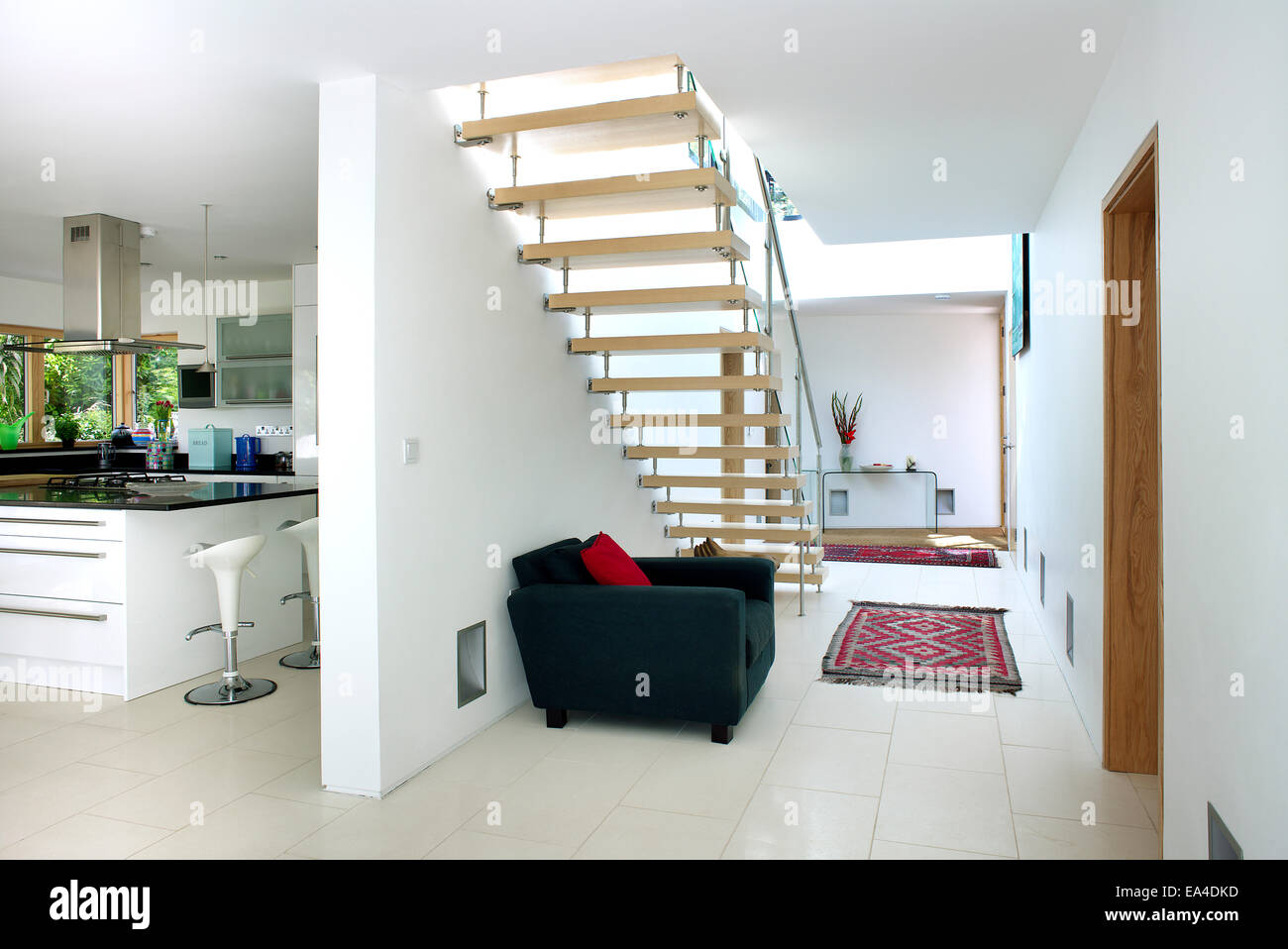 Open plan staircase and hallway with view of kitchen in residential stock photo 75086577 alamy for Open plan hallway and living room