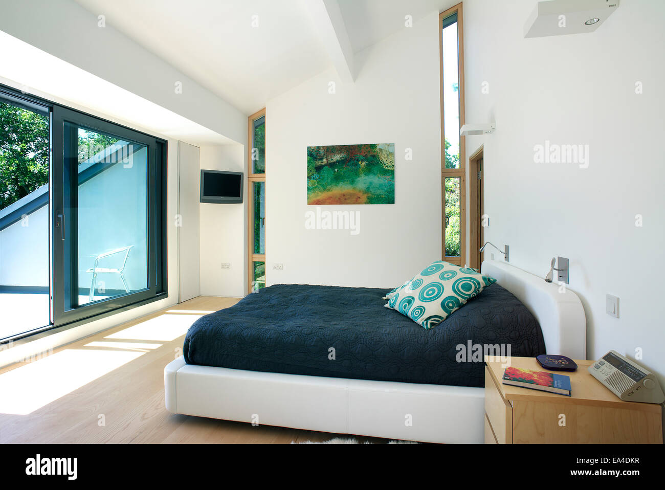 Double Bedroom With Sliding Doors To Balcony In Residential House