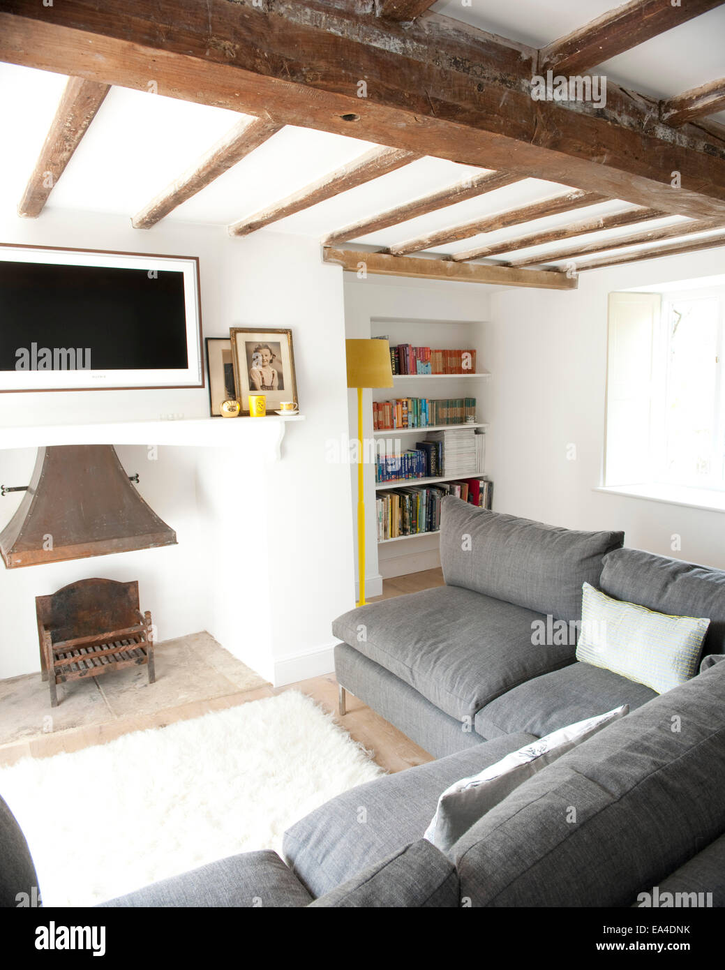 Grey Corner Sofa In Beamed Living Room Of Cottage Interior UK