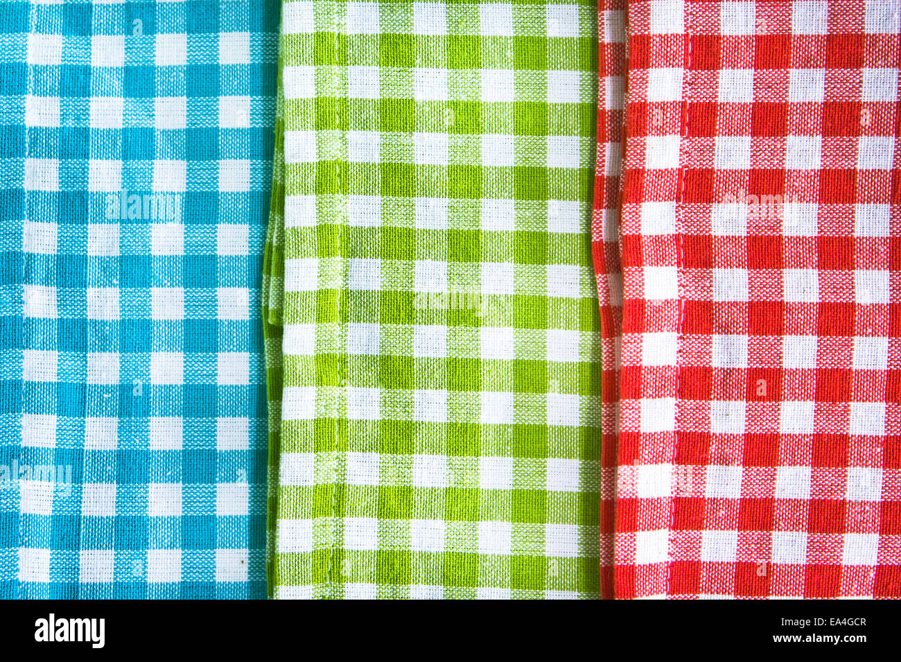 Red,green and blue gingham cloths as a background - Stock Image