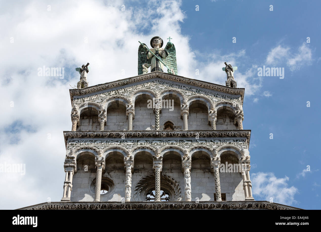 San Michele in Foro, Saint Michael Church, Lucca with the statue of St. Michael the Archangel on top. - Stock Image
