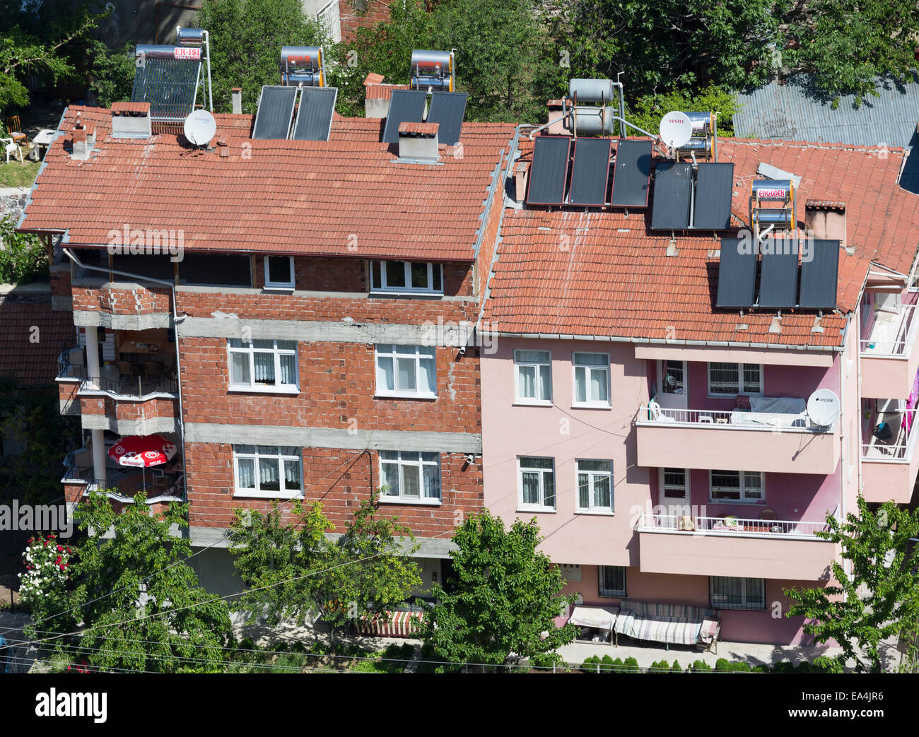 solar panels on roofs of apartment blocks, Niksar town, Anatolia, Turley - Stock Image