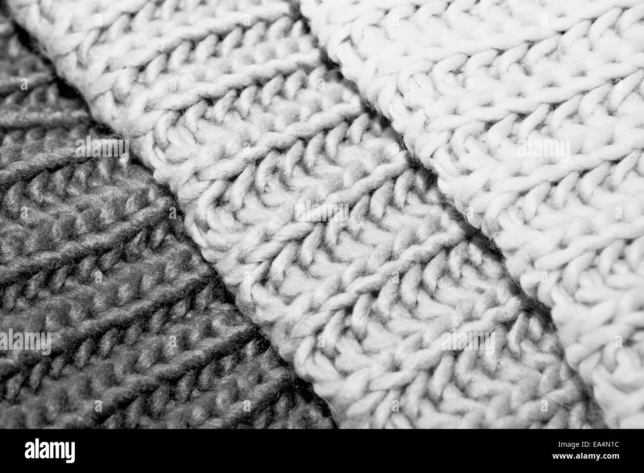 Wool in shades of white,grey and black - Stock Image
