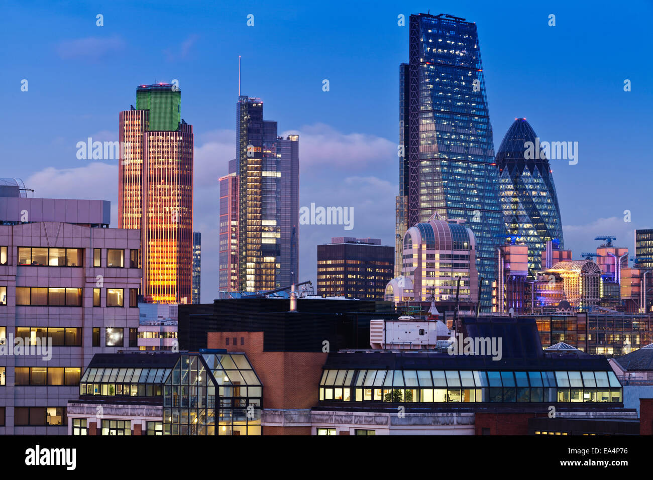 Colorful City of London skyline at twilight with famous modern landmark buildings illuminated - Stock Image
