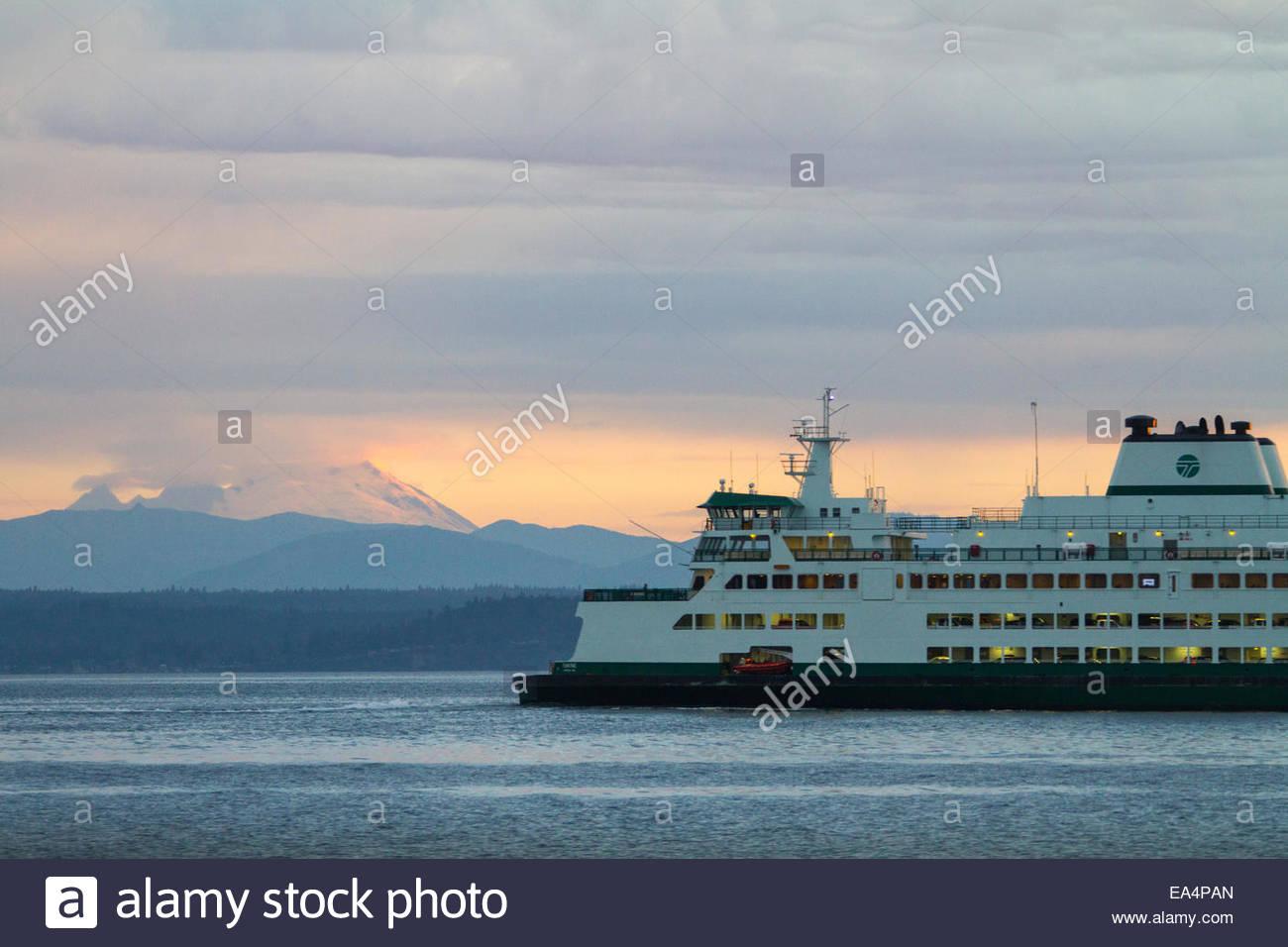 Washington State Ferry on sea with Mount Baker in background - USA - Washington - Stock Image
